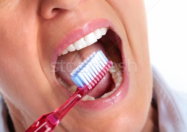 Gyönyörű egészséges mosoly gyönyörű nő fehér fogak fogászati Stock fotó © Kurhan