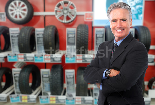Homme pneu Auto entretien affaires Photo stock © Kurhan