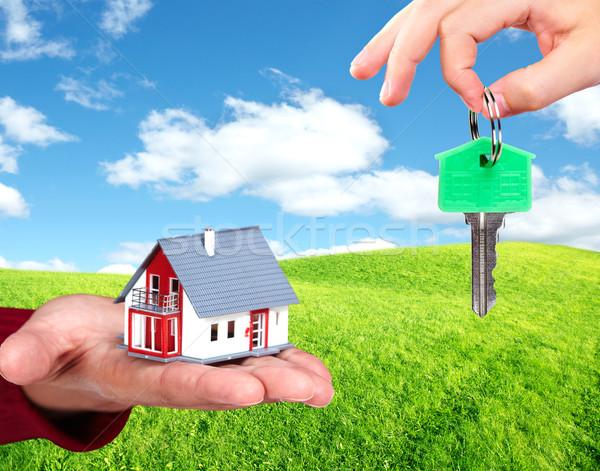 Hand with a little house and keys. Stock photo © Kurhan