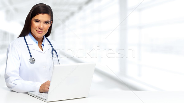 Doctor woman with laptop. Stock photo © Kurhan