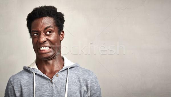 человека черным человеком отвращение лице Выражения портрет Сток-фото © Kurhan