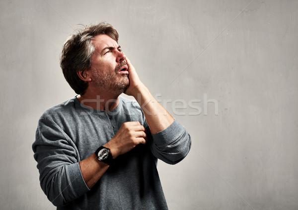 Niespokojny zmartwiony człowiek nieszczęśliwy dojrzały mężczyzna portret Zdjęcia stock © Kurhan