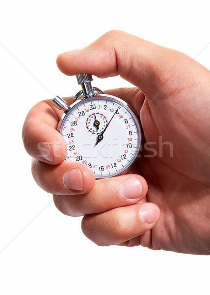 Hand with a stopwatch. Stock photo © Kurhan
