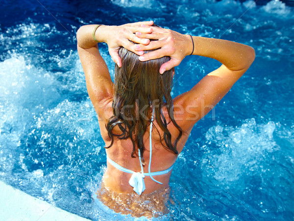Woman relaxing in jacuzzi Stock photo © Kurhan