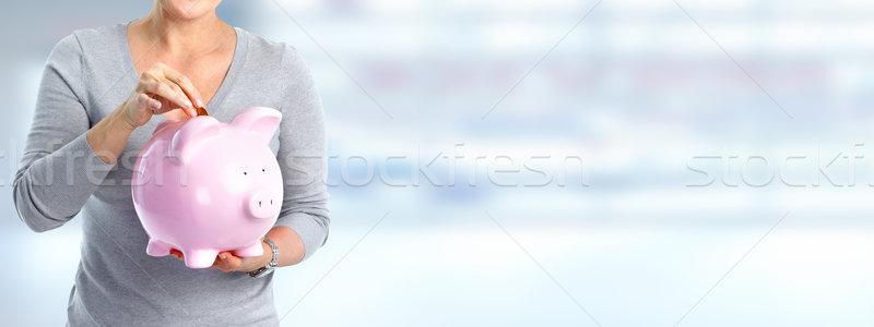 Woman hands with a piggy bank. Stock photo © Kurhan
