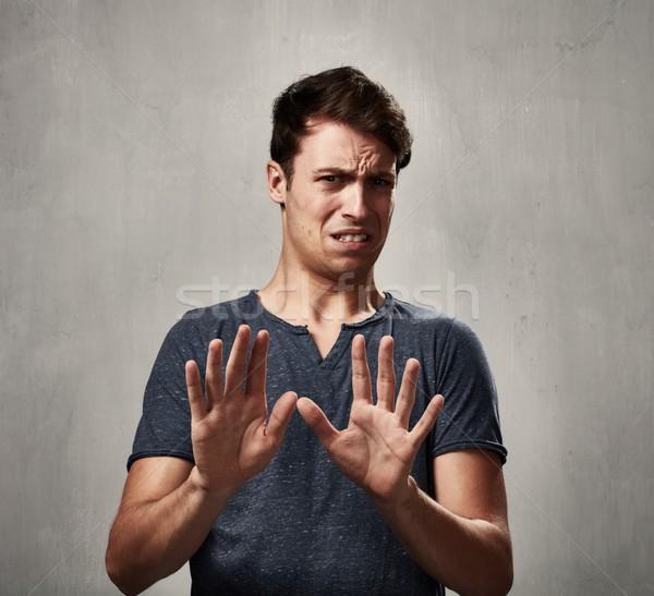 Man jonge man walging gezicht uitdrukkingen portret Stockfoto © Kurhan