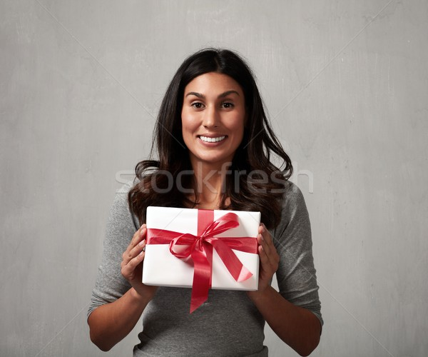 Happy girl with gift. Stock photo © Kurhan