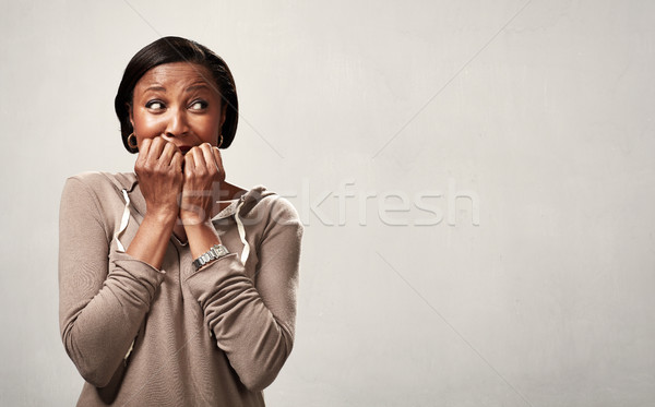 Scared black woman. Stock photo © Kurhan