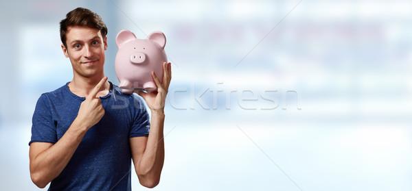 Stockfoto: Glimlachend · man · spaarvarken · jonge · toevallig · roze