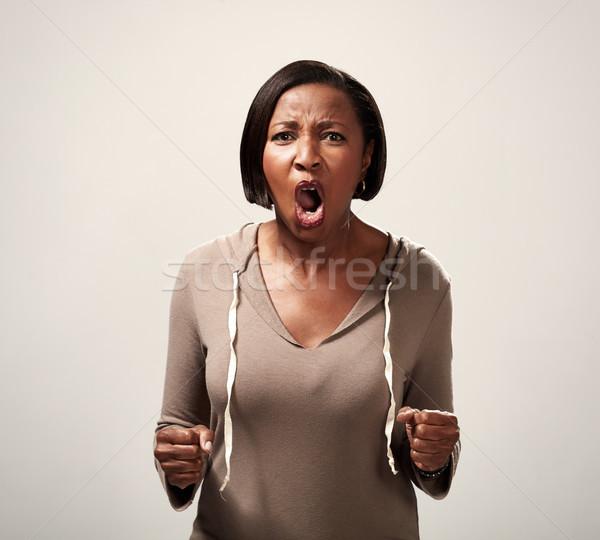 Angry african american woman Stock photo © Kurhan