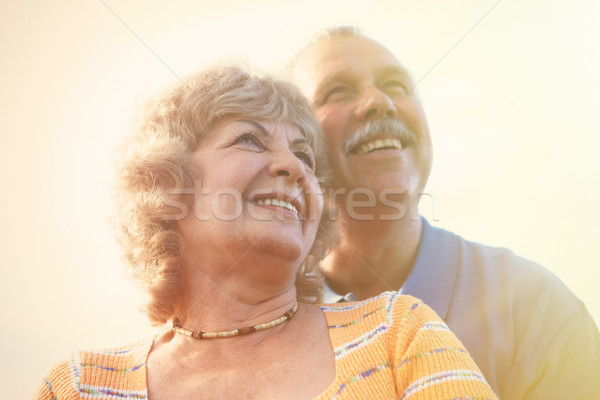 Old people over sky background Stock photo © Kurhan