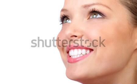 Nő mosoly gyönyörű fiatal mosolyog fehér Stock fotó © Kurhan
