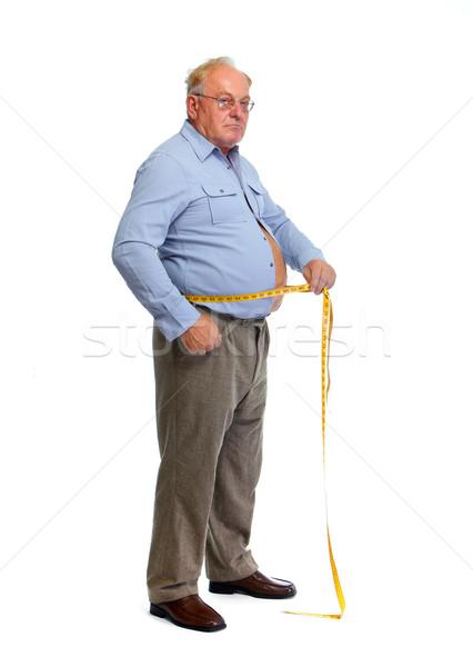 Old man measuring waist with a tape.  Stock photo © Kurhan