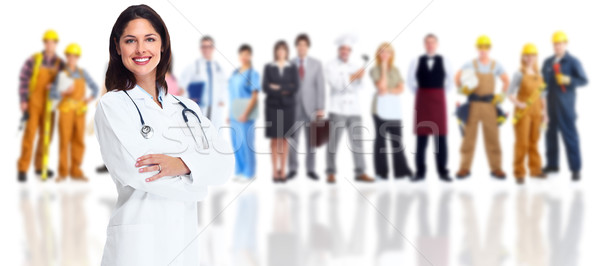 Smiling medical doctor over workers group. Stock photo © Kurhan