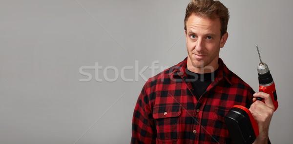 Człowiek wiercenia pracownik budowlany złota rączka domu Zdjęcia stock © Kurhan
