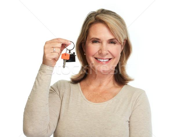 Senior woman with house key. Stock photo © Kurhan