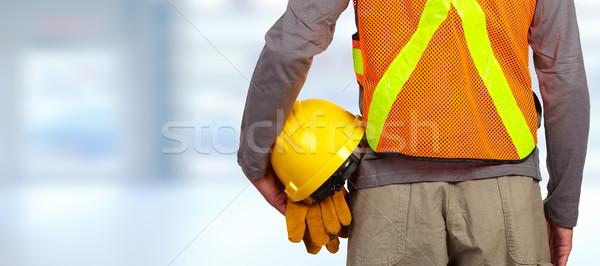 Munkás sisak narancs biztonság mellény építőmunkás Stock fotó © Kurhan