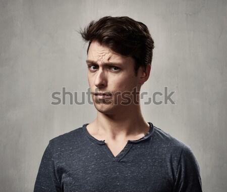 Férfi néz kamera közelkép arc kétség Stock fotó © Kurhan