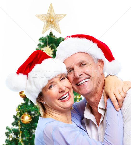 Stock photo: Happy senior santa couple.