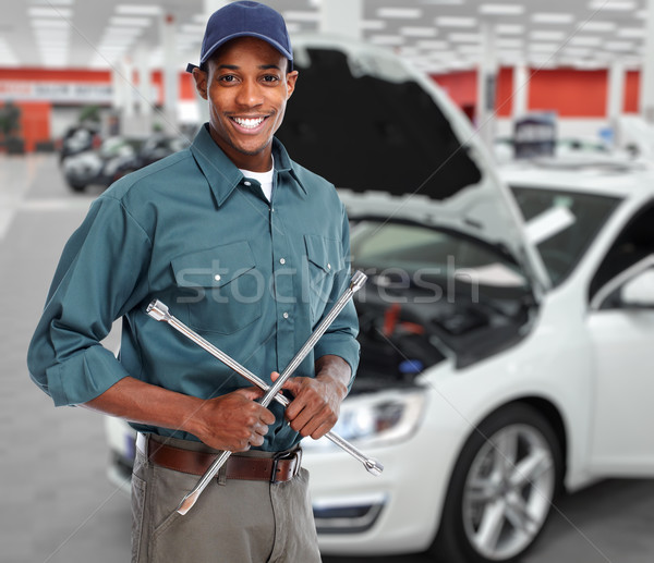 Smiling car mechanic in auto repair service.  Stock photo © Kurhan