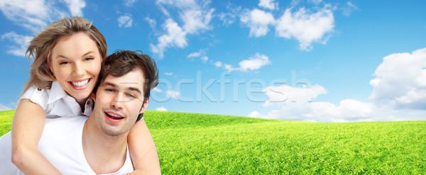 Stock photo: Happy loving couple over blue background.