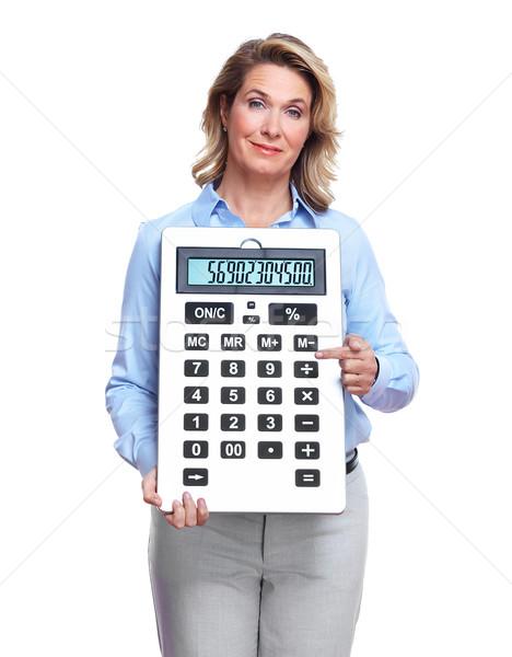 Accountant business woman with a calculator. Stock photo © Kurhan