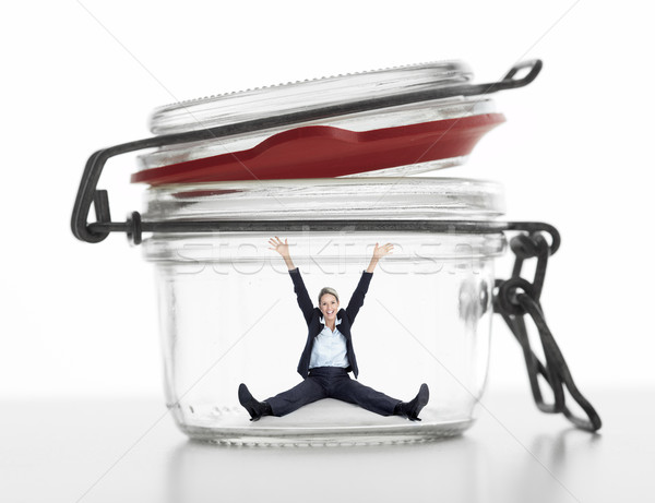 Business woman in jar. Stock photo © Kurhan