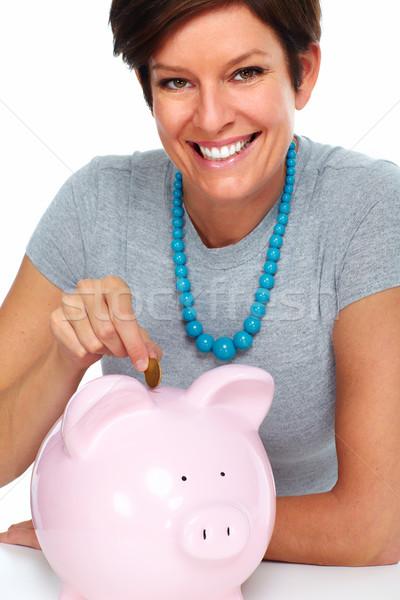 Elderly woman with piggy bank. Stock photo © Kurhan