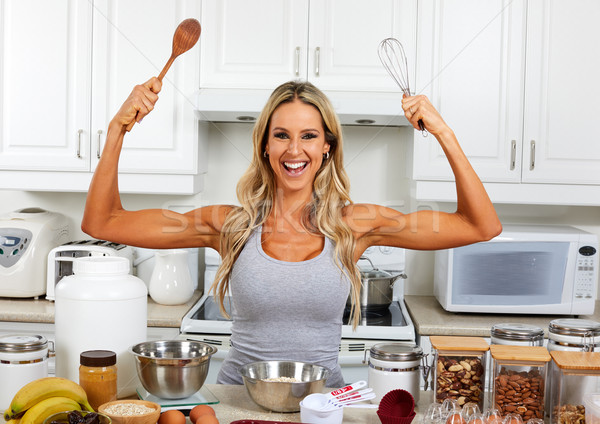 Happy woman with whisk and wooden spoon. Stock photo © Kurhan