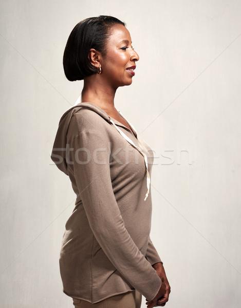 Mujer perfil grave retrato gris Foto stock © Kurhan