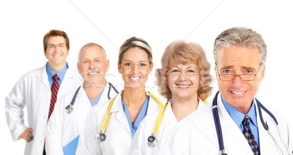 Médicos sonriendo aislado blanco mujer médico Foto stock © Kurhan