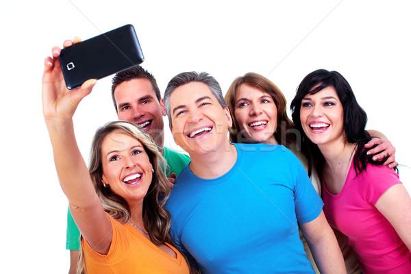 Groep gelukkige mensen smartphone geïsoleerd witte vrouw Stockfoto © Kurhan