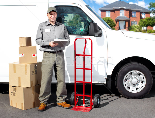 Smiling delivery courier. Stock photo © Kurhan