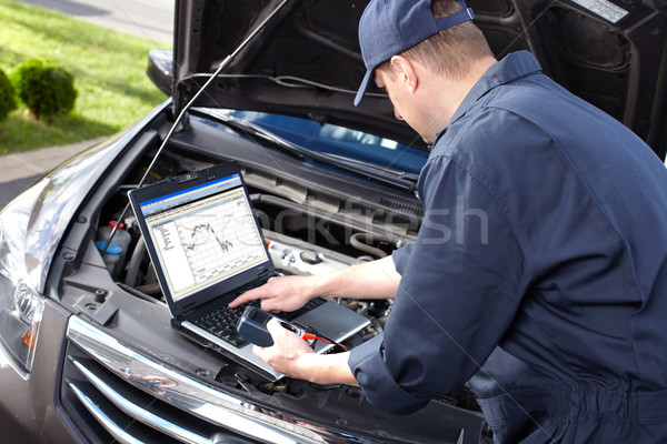 Stock photo: Car mechanic working in auto repair service.