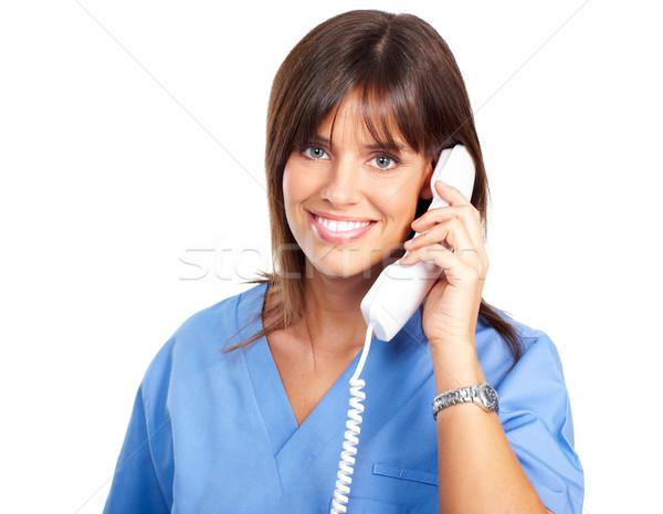 Enfermeira telefone sorridente médico isolado branco Foto stock © Kurhan