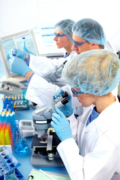 Group of medical doctors in laboratory. Stock photo © Kurhan