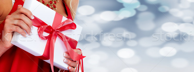 Woman hands with gift. Stock photo © Kurhan