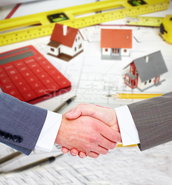 Construction company agent handshake with a client. Stock photo © Kurhan