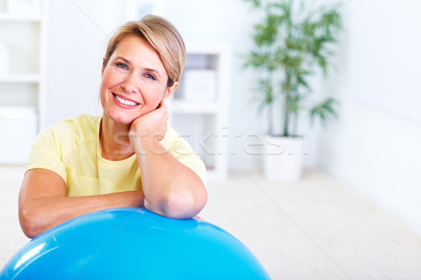 Senior woman doing yoga. Stock photo © Kurhan