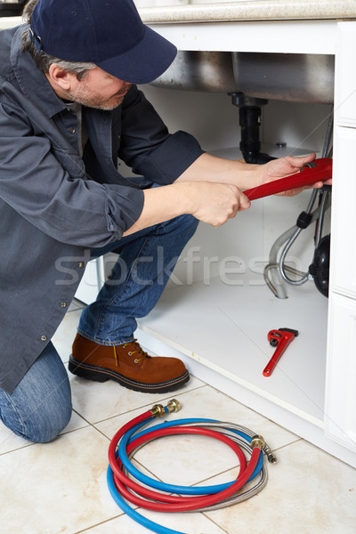 Plumber with wrench. Stock photo © Kurhan