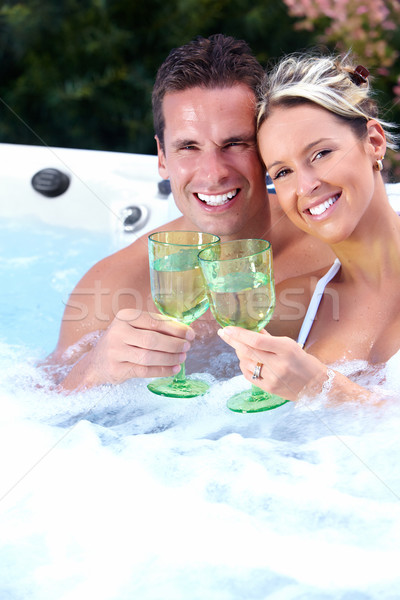 Happy couple in jacuzzi. Stock photo © Kurhan