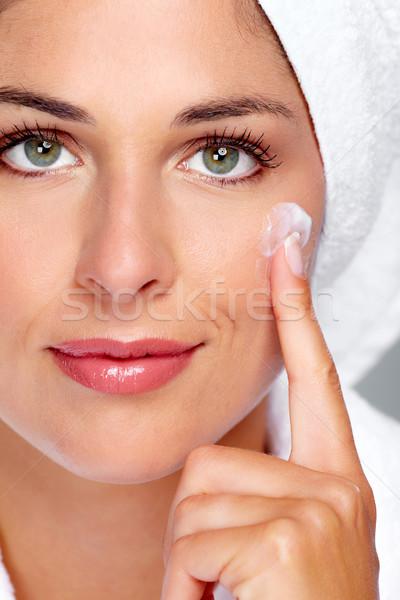 Beautiful woman face with moisturising  cream. Stock photo © Kurhan