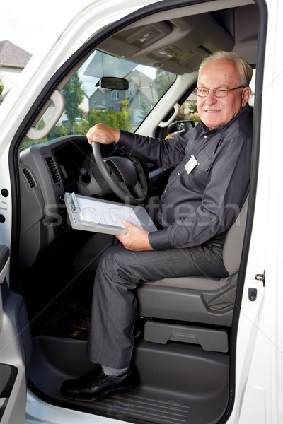 Elderly delivery man in a car. Stock photo © Kurhan