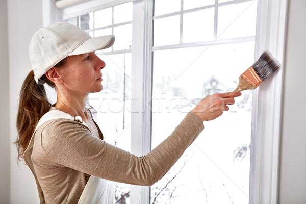 Woman painting window trim Stock photo © Kurhan