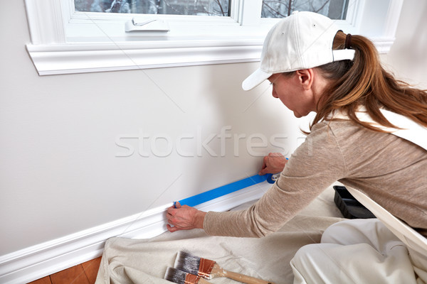 Woman painting wall Stock photo © Kurhan