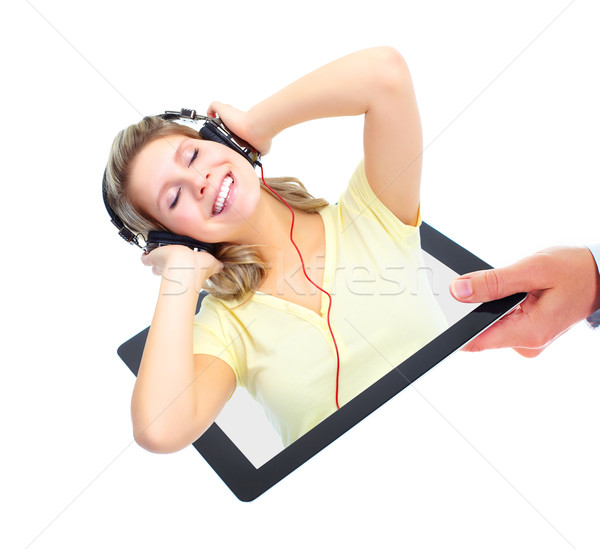 Stock photo: Happy girl listening music. Tablet computer.