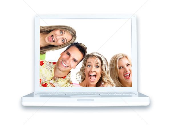 Laptop branco moderno mulher mulheres feliz Foto stock © Kurhan