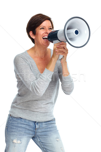 Happy woman talking in megaphone. Stock photo © Kurhan