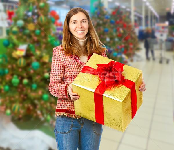 Happy Christmas girl with gift. Stock photo © Kurhan