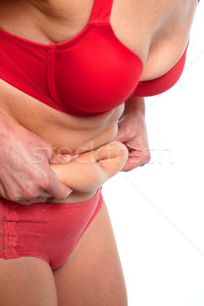 Woman fat belly. Stock photo © Kurhan